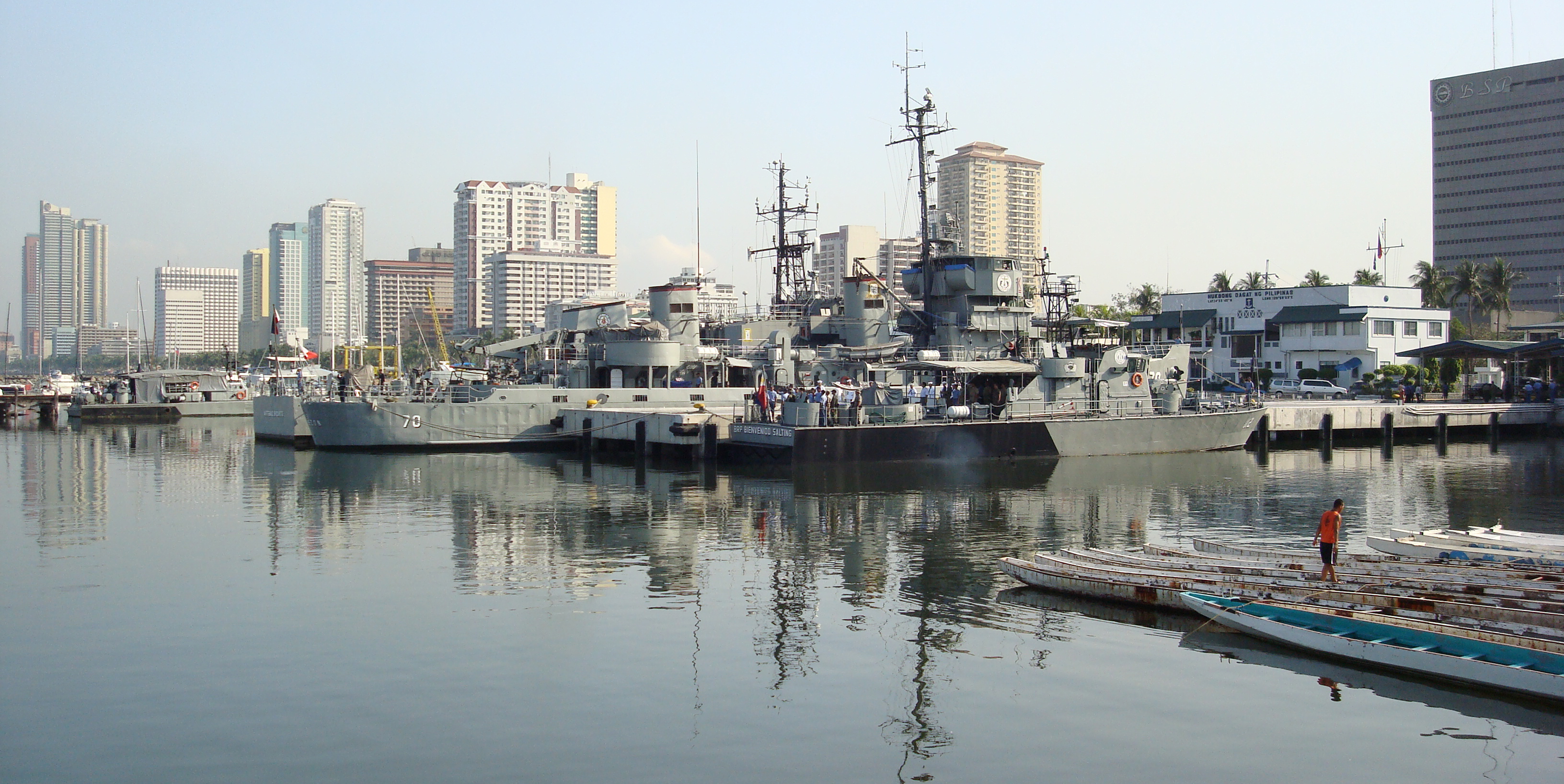 view of philippine navy ships and dragon boats manila bay philippines